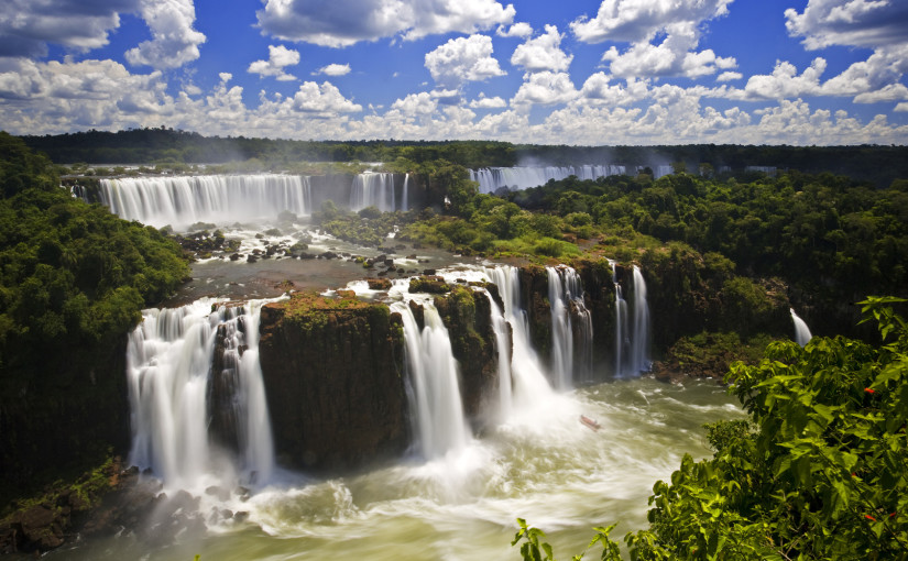 Iguassu Falls is the largest series of waterfalls on the planet, located in Brazil, Argentina, and Paraguay.  At some times during the year one can see as many as 275 separate waterfalls cascading along the edges of 2,700 meters (1.6 miles) cliffs. Argentines spells this wonder, ìIguazuî, the Brazilians, ìIgaucu.î Both versions are globally correct and widely used. South America